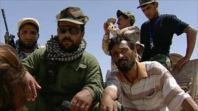 Rebel fighters near Brega