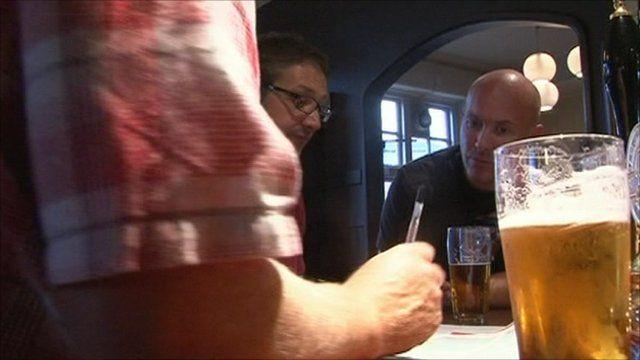 Men doing pub quiz