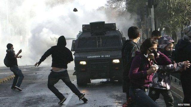 Police vehicle, demonstrators