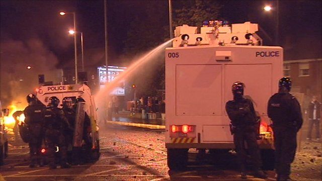 Police use a water cannon to disburse the crowd