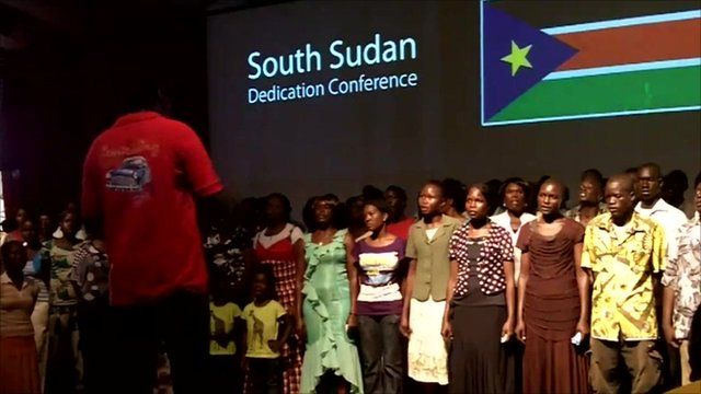 Sudanese people rehearse the national anthem of South Sudan