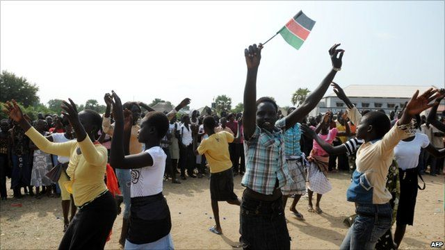 School girl waves South Sudanese flag to celebrate independence
