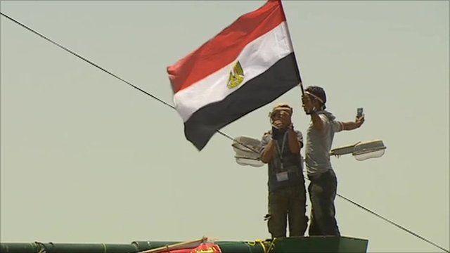 Protester holding Egyptian flag