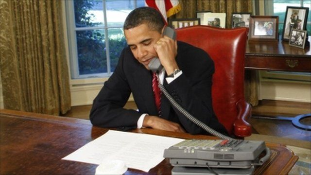 President Obama on the telephone in the Oval Office at the White House