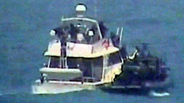 The Dignite-al Karama being boarded by Israeli commandos
