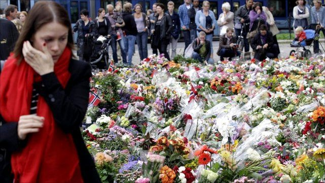Mourners gather in front of Oslo Cathedral in Norway