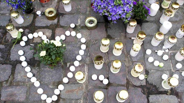 Candles and floral tributes in Oslo