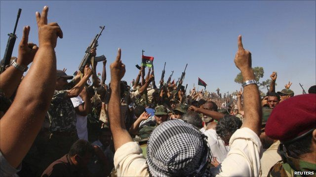 Rebels shoot into the air at Younes' funeral