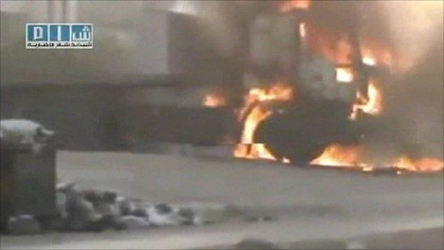 Amateur video footage of truck on fire in Hama