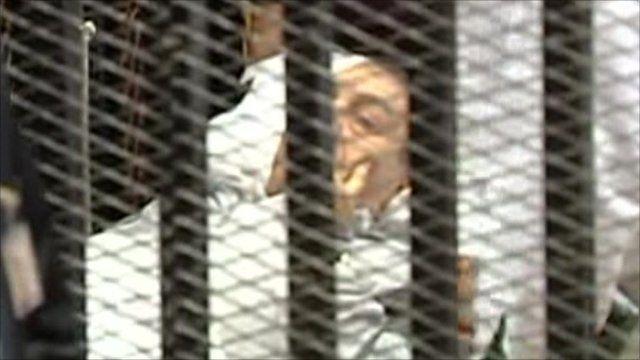Hosni Mubarak on a stretcher in court