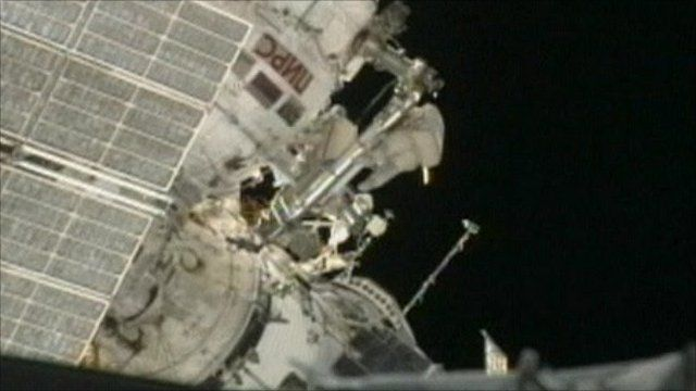 Cosmonaut outside the Russian module of the International Space Station