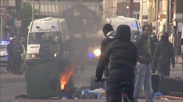 Rioters in front of line of riot police