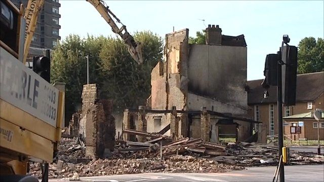 Remains of the Reeves Brothers building in Croydon, that was burnt down in Monday night's fire