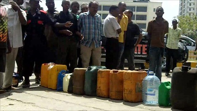 Tanzanians queuing for fuel