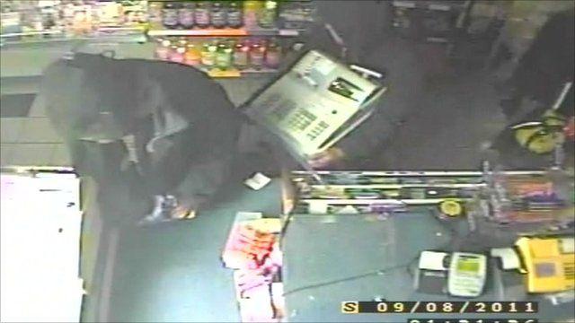 Looters caught on CCTV raiding shop