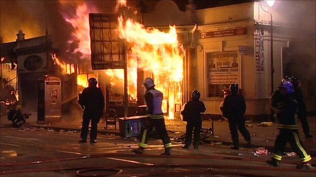 A shop set alight in the riots