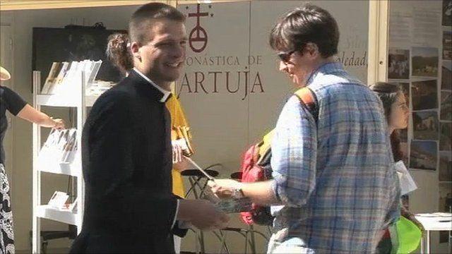 A Catholic handing out leaflets