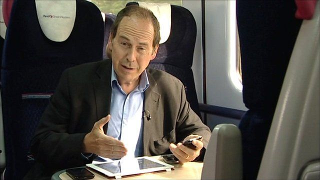 BBC Technology Correspondent Rory Cellan-Jones testing mobile phone signals on a train from Cardiff to London