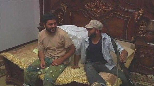 Rebels bouncing on bed in Gaddafi desert retreat