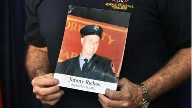 Jim Riches holds a photograph of his son Jimmy who died on 9/11