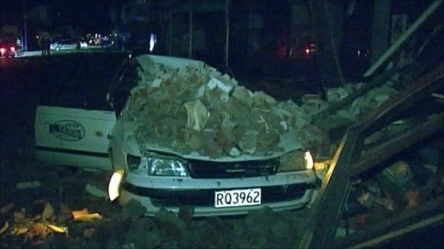Car destroyed by falling masonry in Christchurch