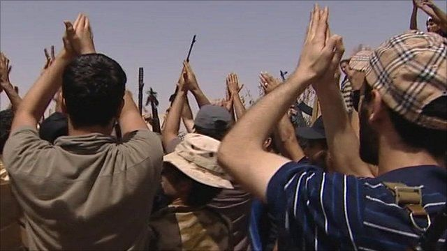 Rebel fighters applauding