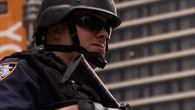 Armed NYPD officer