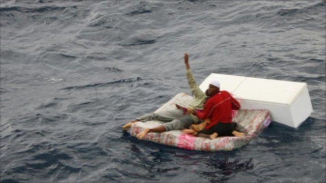 Survivors floating on mattress