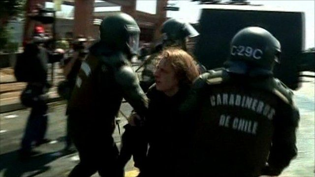 Police arrest a demonstrator in Chile