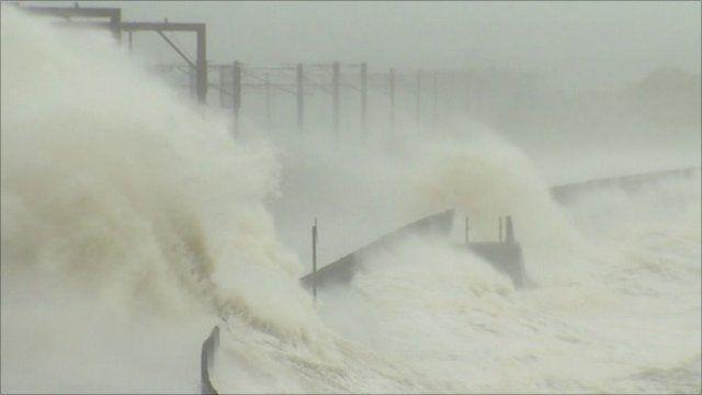Waves crashing over main road
