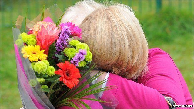 Two women hug at Pontardawe Community Centre