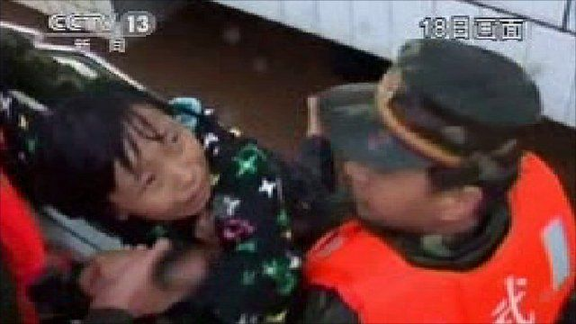 Child is pulled from floodwater