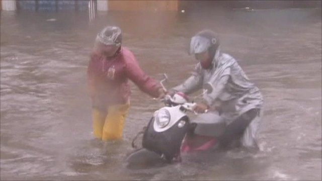 People struggling to make it through flood waters