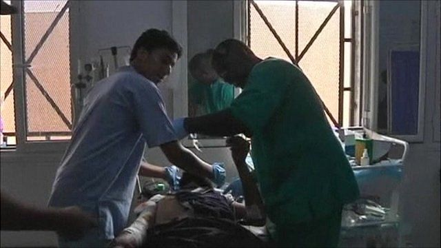 Libyan doctors working on patient in hospital