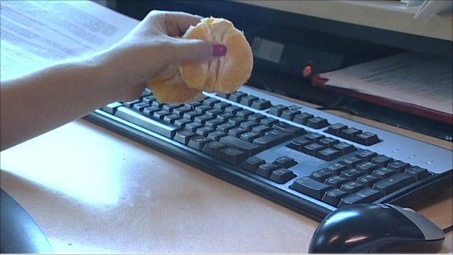 Eating an orange over a keyboard