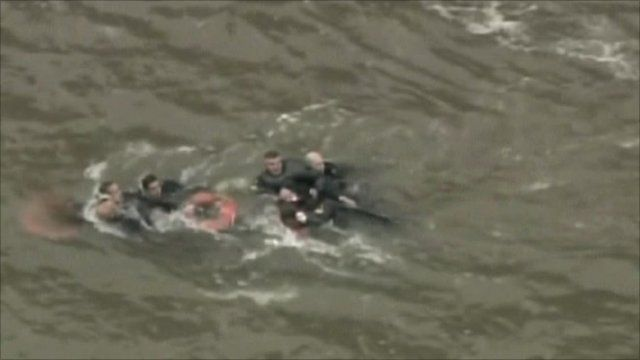 Helicopter passengers being rescued