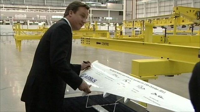 David Cameron signing a model wing