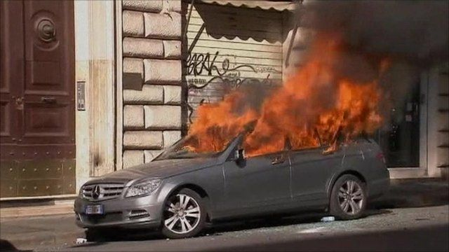 Burning car in Rome