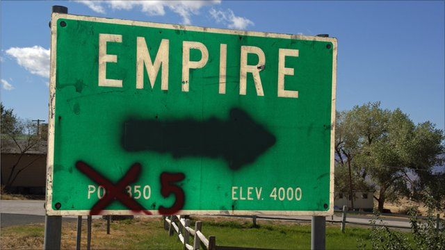 Empire, Nevada sign with population spray painted to five
