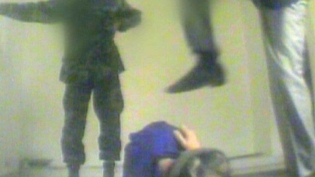 Image of man being kicked