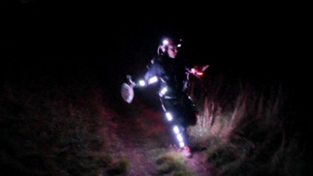 Runner wearing a suit covered in lights