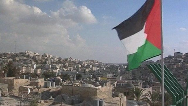 Palestinian flag flies over the Old City of Hebron, West Bank