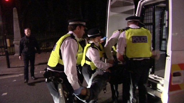 Police putting protester into police van
