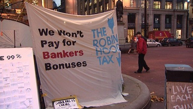 Signs in the anti-capitalist protest camp in George Square, Glasgow