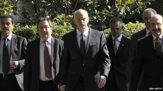 George Papandreou surrounded by aides and security