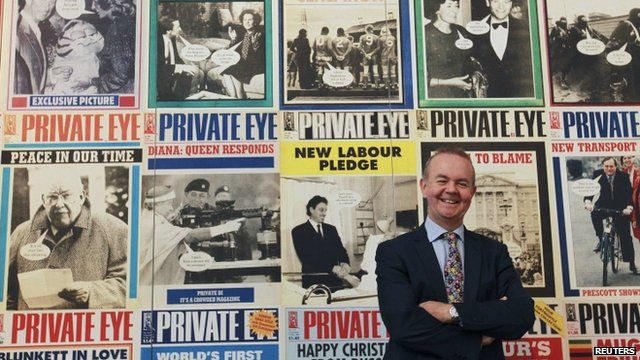 Ian Hislop in front of Private Eye front pages