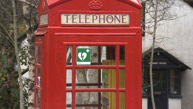 Red telephone box with a defibrillator sign