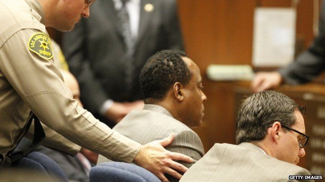 """A Los Angeles County Sheriff""""s Deputy remands Dr. Conrad Murray"""