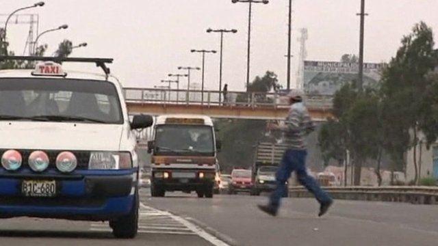 Pedestrian crossing road in Lima
