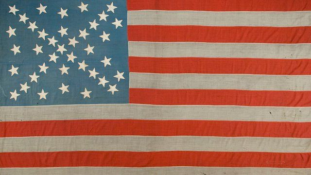 Stars and stripes flag with confederate cross among the stars (photo from Jeff Bridgman)